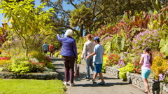 Victoria BC Family Walking Along Gardens of Beacon Hill Park Stock Footage
