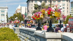 Victoria BC Flowers on City Street Scene with Tourists on Sunny Day Stock Footage