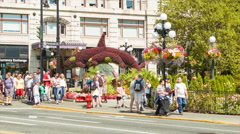 Victoria BC City Street Scene with Tourists and Flowers on Sidewalk Stock Footage