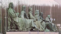Bronze figures of jurists + zoom out  Supreme Court of the Netherlands Stock Footage