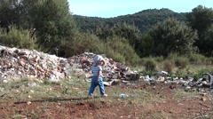 Small child comes and plays on junkyard Stock Footage