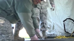 LOUISIANA USA, JANUARY 2016, Close Up US Soldiers Cover The Bottom Tent Stock Footage