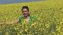 Girl In A Blooming Rapeseed Field Stock Footage
