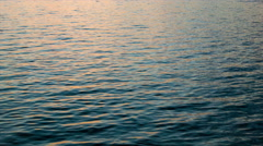 Cruising Water Surface Sun Reflection Movement Close-up Stock Footage