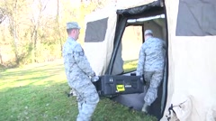 LOUISIANA USA, JANUARY 2016, Two Soldiers Carry Case In Joint Incident Site Stock Footage