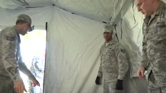 LOUISIANA USA, JANUARY 2016, US Air Force Soldiers Stack Case In Tent - stock footage