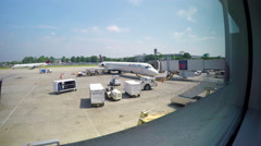 Charlotte Douglas Airport Terminal with Delta Airlines Airplane at Jetway Stock Footage