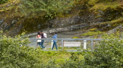 People Walking Along Path Close Up at Mendenhall Glacier Stock Footage