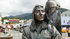 Ketchikan Alaska Historical Bronze Statue with Downtown Background Stock Footage