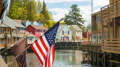 Popular Ketchikan Alaska Creek Street with American Flag Stock Footage