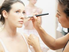 Model having make-up applied Stock Photos