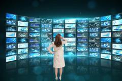 Businesswoman analysing data on screen Stock Photos