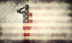 Double exposure of saluting soldier on USA grunge flag. Patriotic design Stock Photos