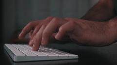 Hands typing on sleek keyboard Stock Footage