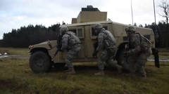 BOEBLINGEN GERMANY, JANUARY 2016, US Army Armed Vehicles Drive Soldiers Walk Stock Footage