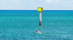 Surfer in Tropical Water Swimming Out to Deeper Sea Stock Footage