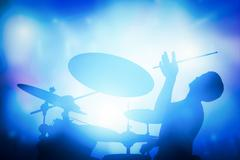 Drummer playing on drums on music concert. Club lights - stock illustration