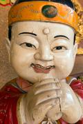 Asian Buddhism wooden statue Stock Photos