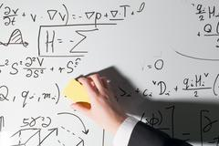 Whiping the whiteboard. Complex math formulas. Mathematics and science Kuvituskuvat