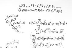Complex math formulas on whiteboard. Mathematics and science with economics - stock photo