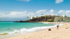 People Enjoying Sandy Kaanapali Beach in Maui Hawaii Stock Footage