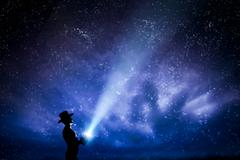 Man in hat throwing light beam up the night sky full of stars. Conceptual - e Stock Illustration