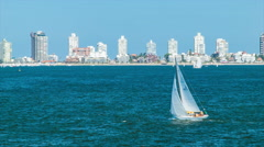 Punta del Este City Skyline Background with Sailboat in Foreground Stock Footage