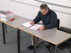 Teacher marking paperwork Stock Photos