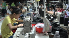 Employees of a garment factory work on production line in Saigon, Vietnam Stock Footage