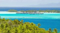 Bora Bora Tropical Medium Lagoon Scene with Over Water Bungalows Stock Footage