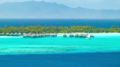 Bora Bora Bungalows Over The Tropical Water in French Polynesia Stock Footage