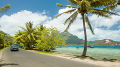 Bora Bora Island Main Coastal Road Along Beach with Palm Trees Stock Footage