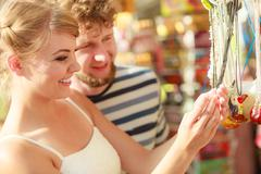young couple buying souvenirs outdoor - stock photo