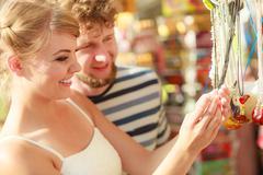 Young couple buying souvenirs outdoor Stock Photos