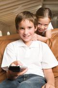 Sister and brother with remote control Stock Photos