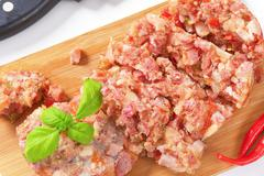 Pork meat with fresh chili pepper in aspic Stock Photos