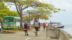 Suva Fiji Tourists Walking and Cycling the Waterfront Stock Footage