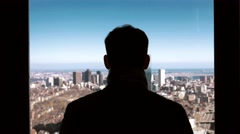 Young entrepreneur and businessman looking at the skyline of the city Stock Footage
