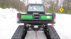 Tracked snow utility vehicle driving Stock Footage