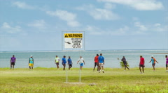 Fiji Locals Playing Rugby on Waterfront Grass Field in Suva Close-up - stock footage