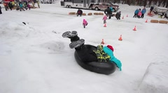 boy tubing in winter - stock footage