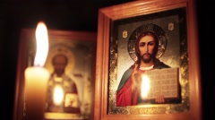 Orthodox Icons And Candle - stock footage
