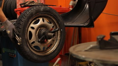 Replacement of a wheel in a garage Stock Footage