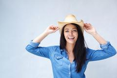 Cheerful woman laughing with cowboy hat - stock photo
