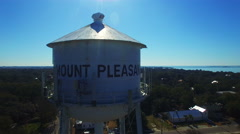 Mt Pleasant slow aerial descent on water tower Stock Footage