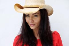 attractive young woman wearing cowboy hat - stock photo
