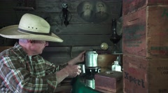 Cowboy in the bunkhouse, hot flavorful coffee Stock Footage