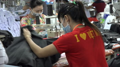 Industrial worker wears 'I love Vietnam' shirt on factory floor Stock Footage
