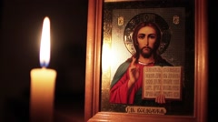 Orthodox Icon of Jesus Christ And Candle - stock footage