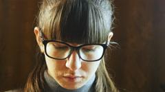 Beautiful woman in big black glasses reading - stock footage